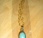 A turquoise lady's pendant