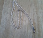 Metal feather and silver chain