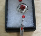 Another coral feather and bead necklace