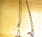 Silver rat on a chain