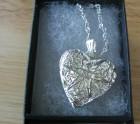 Silver filigree heart locket