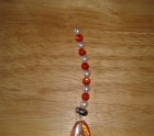 Silver and orange beaded sun catcher
