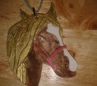 Gold and silk horse head hanger